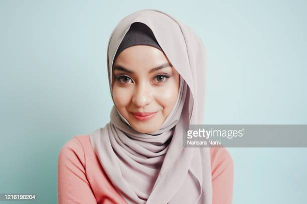 portrait of asian cute smile muslim teenage girl wearing islamic dress hijab is looking to camera. - beautiful ramadan stock pictures, royalty-free photos & images