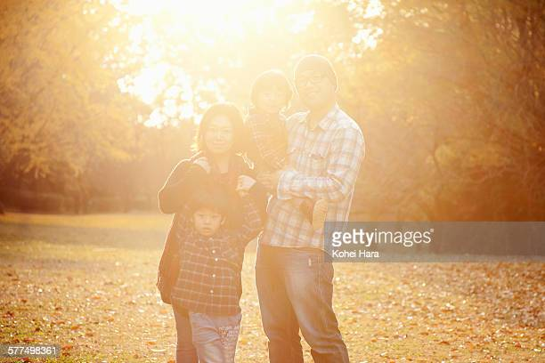 portrait of asian family in the park in autumn