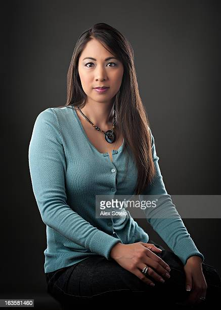 Portrait of Asian Female Sitting with Legs Crossed