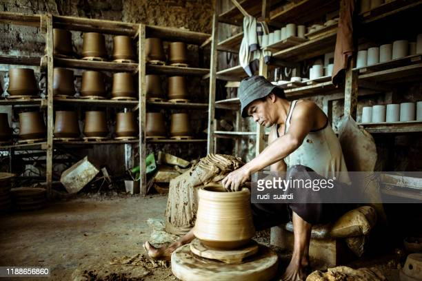 portrait of asian man pottery artist in art studio - bandung stock pictures, royalty-free photos & images