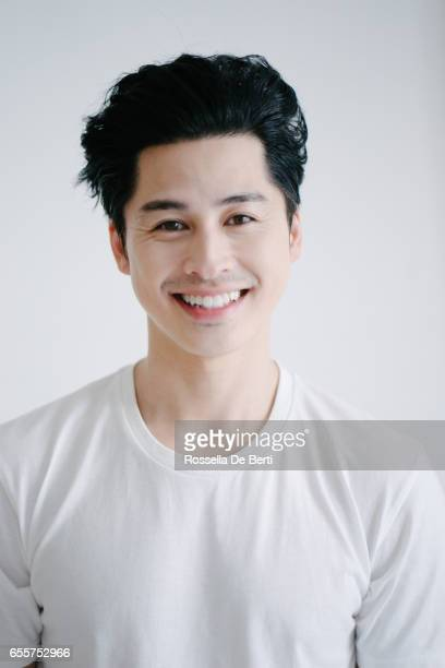 Portrait of asian man smiling, white background