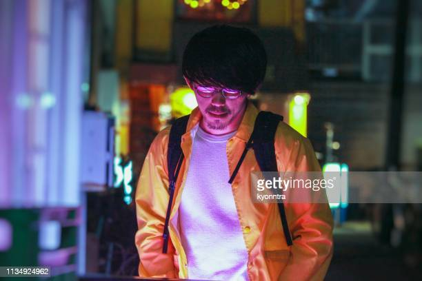 Portrait of asian man with Neon illuminated