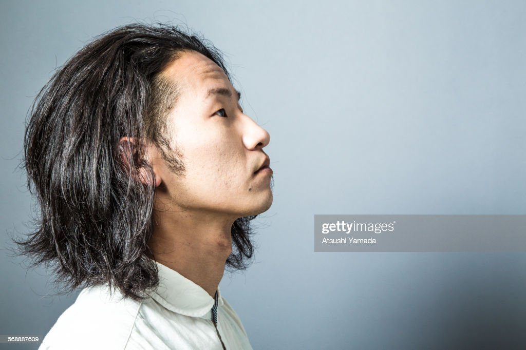 Portrait of Asian man,side view : Stock Photo