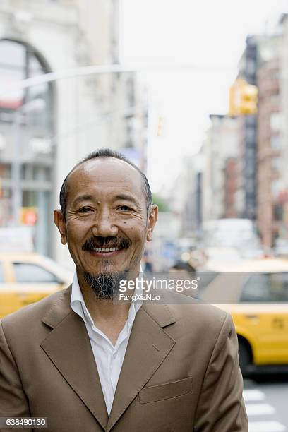 portrait of asian mature man in downtown city - new yorker building stock photos and pictures
