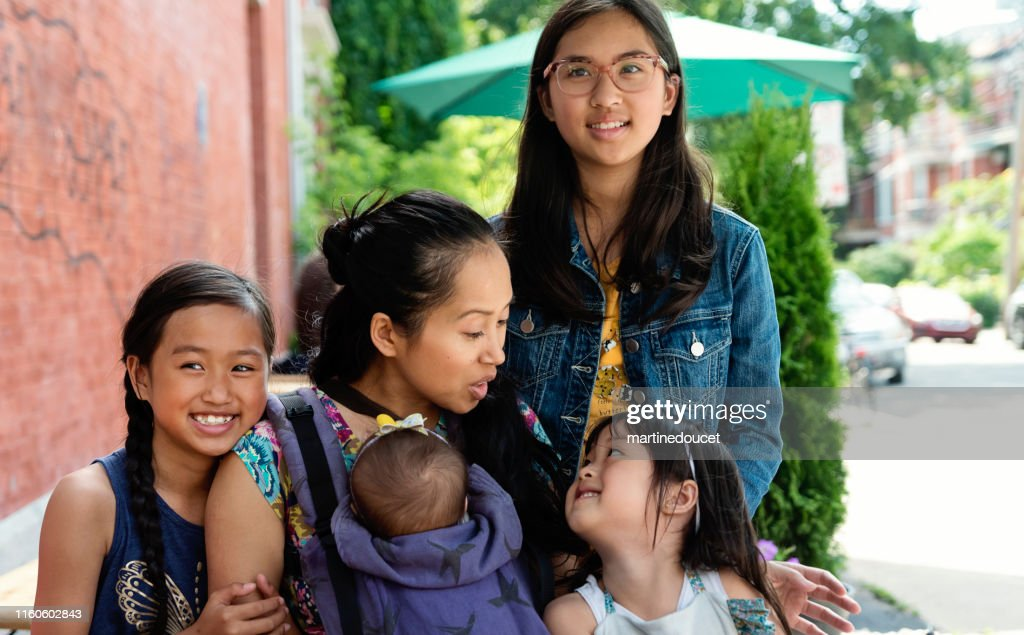 Portrait of asian mother and four daughters outdoors. : Stock Photo