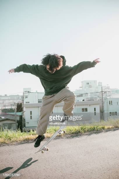 portrait of asian skater - ollie pictures stock pictures, royalty-free photos & images