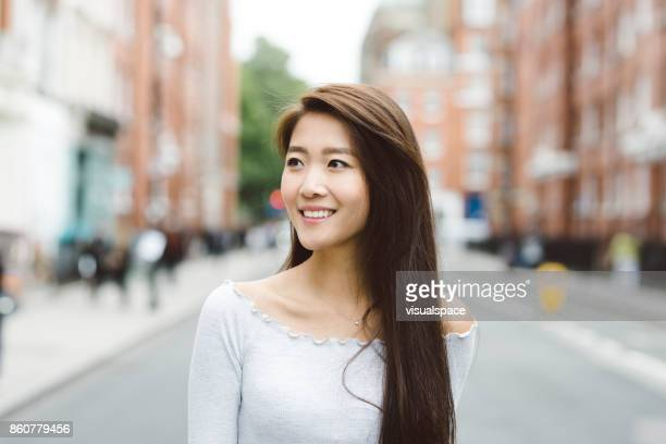 Portrait of Asian Student on Streets of London