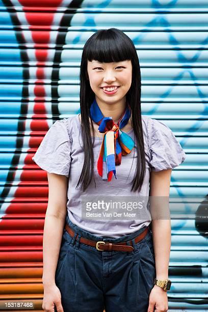 portrait of asian woman in front of graffiti wall. - ネッカチーフ ストックフォトと画像