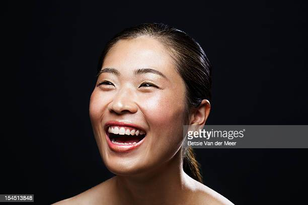 portrait of asian woman laughing. - east asian ethnicity stock pictures, royalty-free photos & images