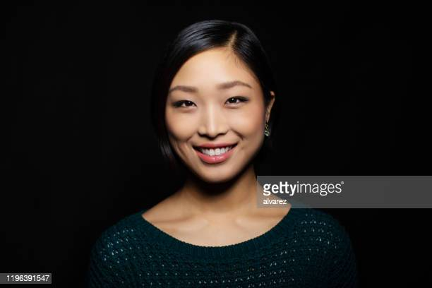 portrait of asian woman looking confident - east asian ethnicity stock pictures, royalty-free photos & images