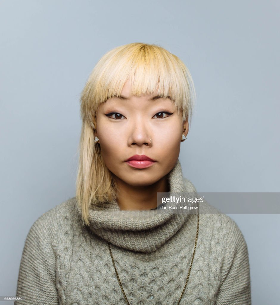Portrait of Asian woman with blonde hair : Stock Photo