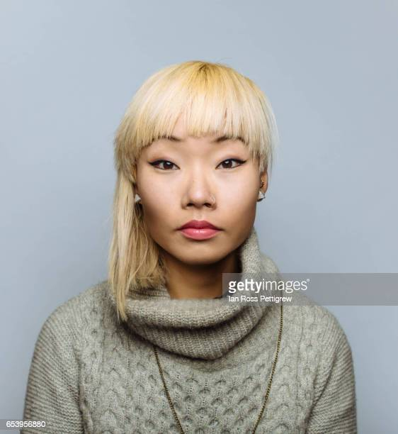Portrait of Asian woman with blonde hair