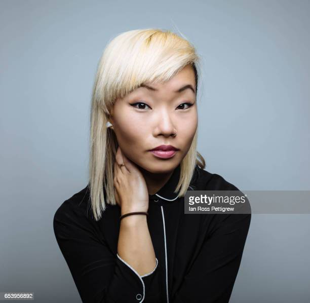portrait of asian woman with blonde hair - asian model stock photos and pictures