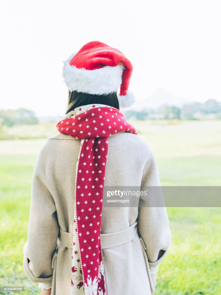 8580931c50d Portrait Of Asian Woman With Santa Hat And Scarfrear View Stock ...