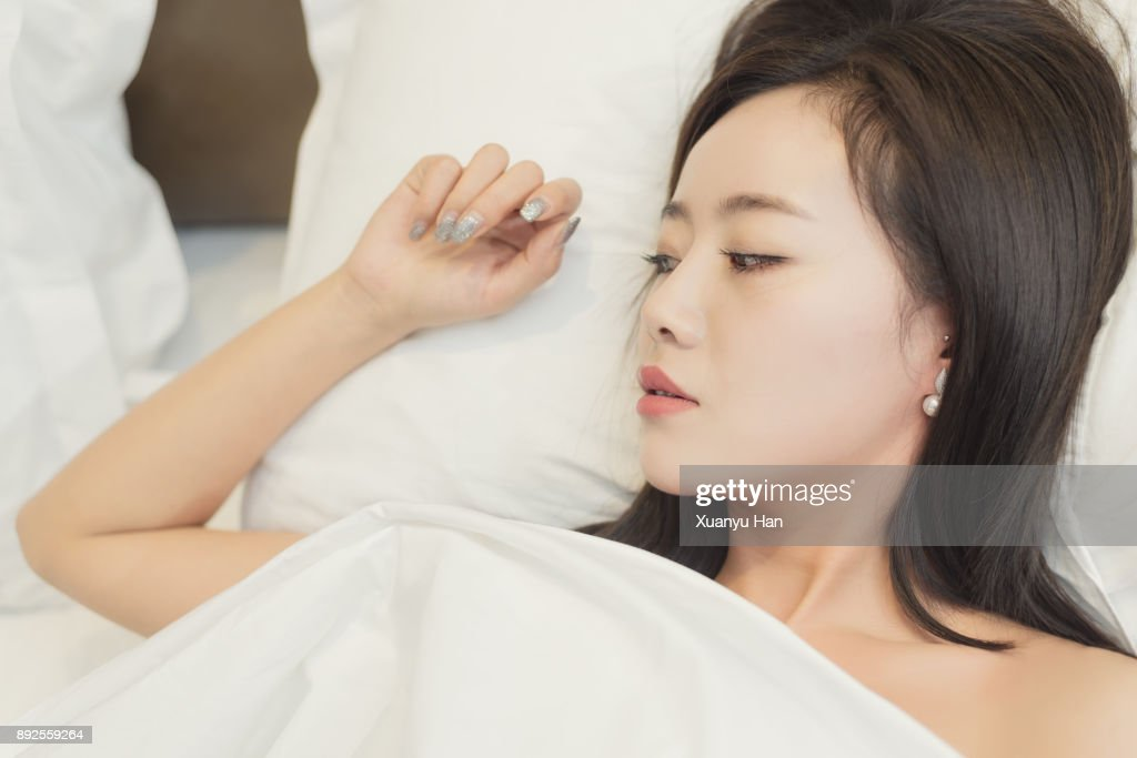 Portrait Of Asian Women Lying On The Bed Stock Photo -3977