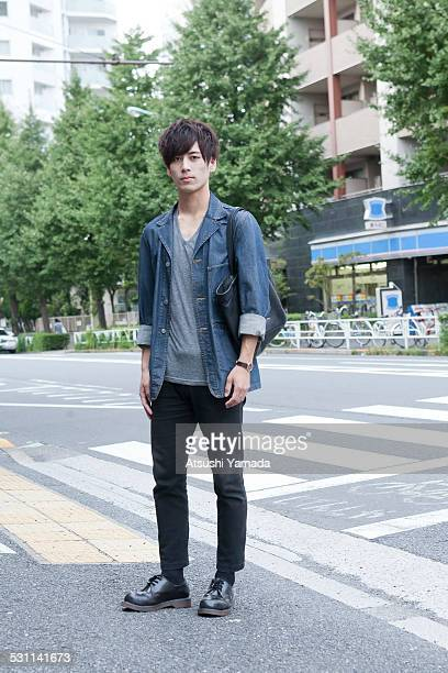 Portrait of asian young man on street