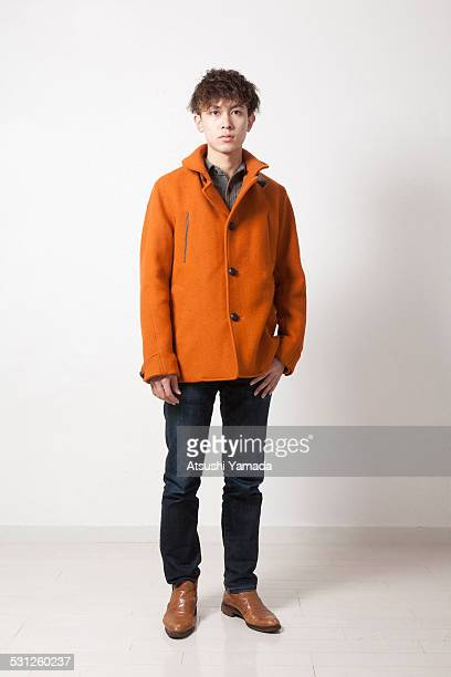 portrait of asian young man - overcoat stock pictures, royalty-free photos & images