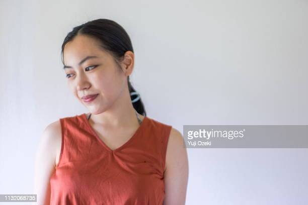 portrait of asian young woman with ponytail - ノースリーブ ストックフォトと画像