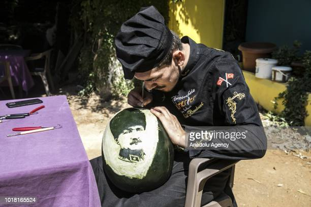 A portrait of Ataturk carved on a watermelon by cook Halil Bozkurt is seen in Turkey's Hatay on August 17 2018 Bozkurt carves portraits of well known...