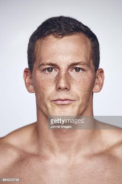 Portrait of athlete on gray background