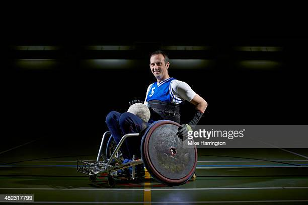 portrait of athlete prepared for wheelchair rugby - personne sportive photos et images de collection