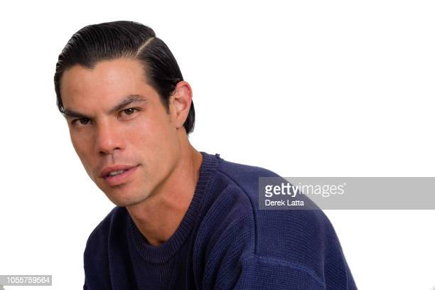 Portrait of attractive Asian American male in his 30s with confident expression'n