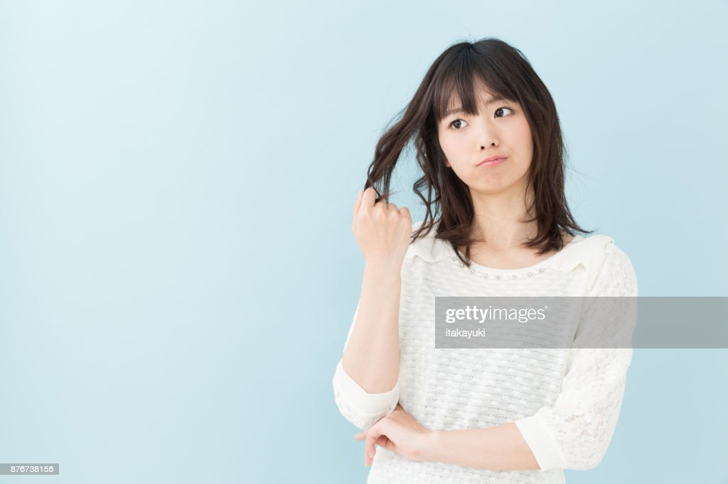 portrait of attractive asian woman isolated on blue background : Stock Photo