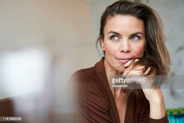 portrait of attractive brunette woman - one mature woman only stock pictures, royalty-free photos & images