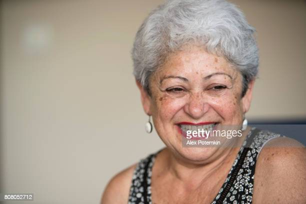 portrait of attractive positive active senior retired 65-years-old woman - 65 69 years stock photos and pictures