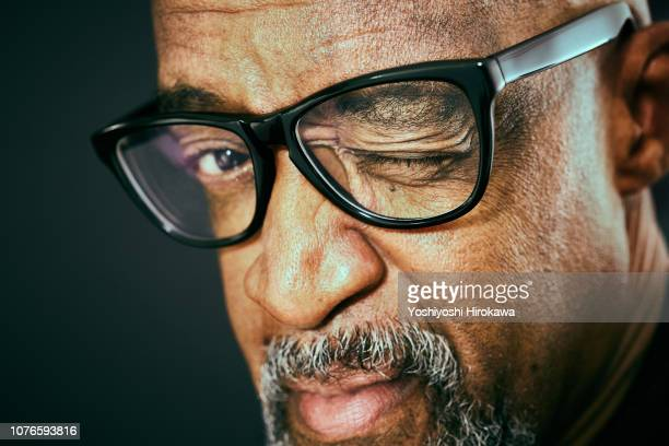 portrait of attractive senior african american. - horn rimmed glasses stock pictures, royalty-free photos & images
