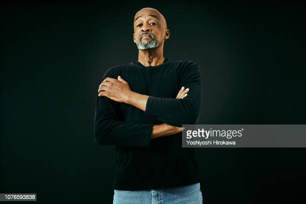 portrait of attractive senior african american. - arrogance stock pictures, royalty-free photos & images