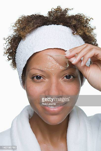 Portrait of attractive woman with facial mask