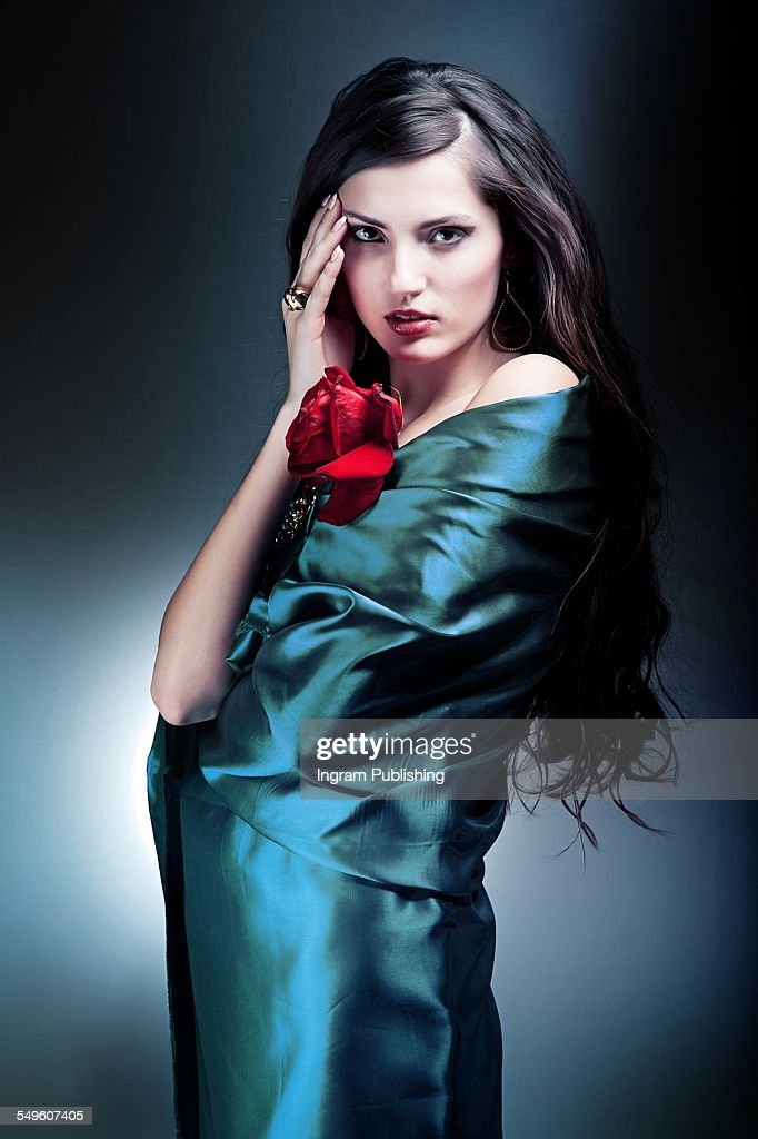 https://media.gettyimages.com/photos/portrait-of-attractive-woman-wrapped-in-silk-fabric-picture-id549607405