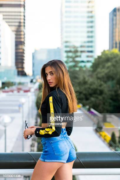 Portrait of attractive young woman in the city