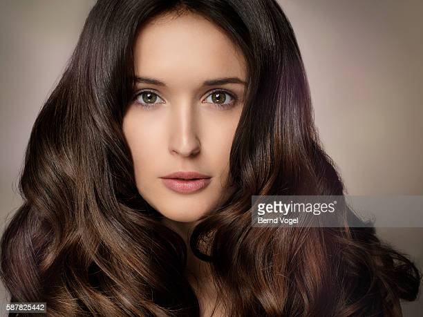 portrait of attractive young woman - wavy hair stock pictures, royalty-free photos & images