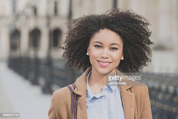 portrait of attractive young woman with curly hair - brown coat stock pictures, royalty-free photos & images