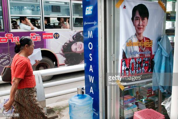 A portrait of Aung San Suu Kyi is posted on the door of a shop downtown Yangon