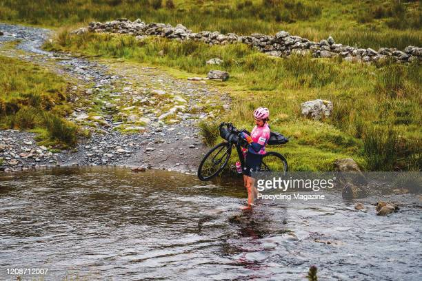 Portrait of Australian professional road racing cyclist Lachlan Morton, photographed near Nant-y-moch reservoir in Wales during the GBDuro race on...