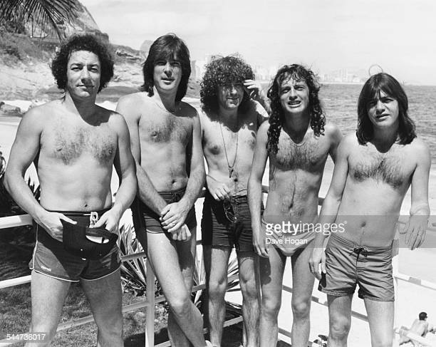 Portrait of Australian rock band AC/DC wearing swimming shorts on Ipanema Beach in the country to perform at Rio music festival Brazil January 24th...
