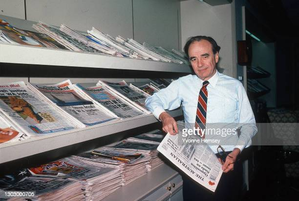 Portrait of Australian-born American media executive Rupert Murdoch as he poses, beside a display rack of periodicals he owns, in his office at the...