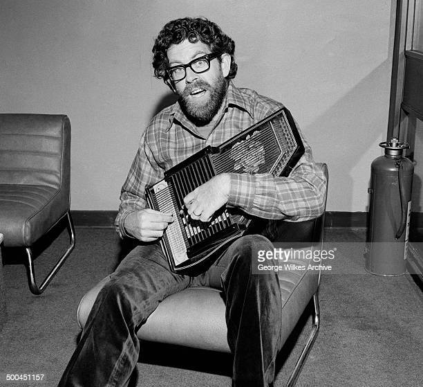 Portrait of Australianborn British entertainer Rolf Harris as he plays an autoharp London England July 1974