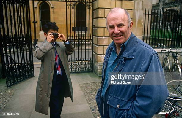 A portrait of Australianborn Clive James as he is recognised and photographed by a Japanese tourist on 20th January 1990 in Cambridge UK Clive James...