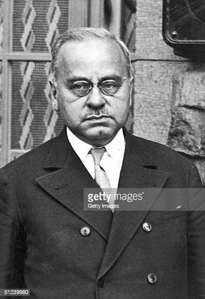 Portrait of Austrian psychoanalyst Dr Alfred Adler dressed in a double breastest suit coat and tie as he stands outdoors 1930s