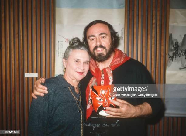 Portrait of Austrianborn American performing arts director Beate Sirota Gordon of the Asia Society and Italian tenor Luciano Pavarotti at a press...