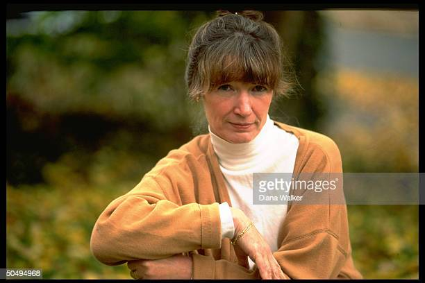 Portrait of author Anne Tyler posing outside home