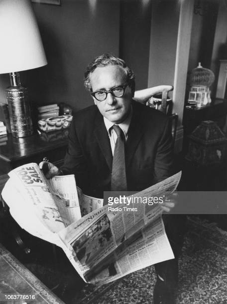 Portrait of author Bernard Nossiter reading a newspaper January 16th 1973