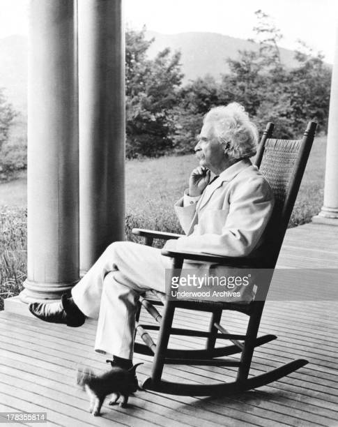 A portrait of author Mark Twain in a rocking chair on a porch Dublin New Hampshire September 1906