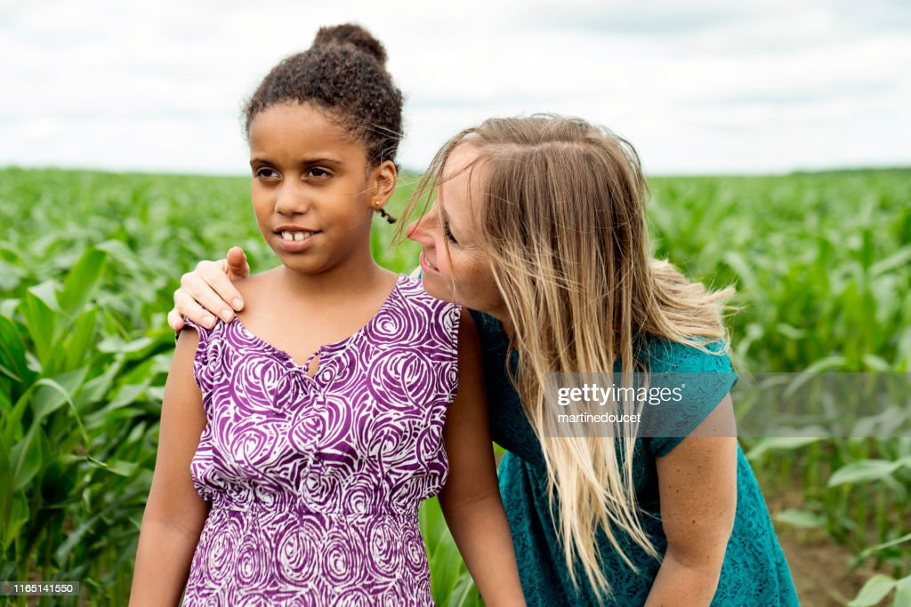 Portrait of autist young girl with instructor in nature. : Stock Photo