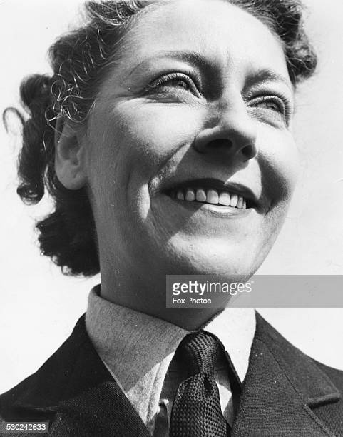Portrait of aviator Amy Johnson wearing a tie and uniform circa 1930