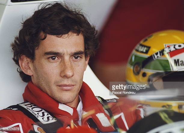 Portrait of Ayrton Senna of Brazil as he sits aboard the Honda Marlboro McLaren McLaren MP4/5 Honda V10 during practice for the Hungarian Grand Prix...